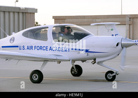 Lt. Gen. Mike Gould and Cadet 1st Class Luke Hyder prepare to taxi after performing pre-flight checks of the newest - Stock Photo