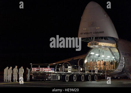 A C-5M Super Galaxy assigned to the 436th Airlift Wing, transported the remains of two fallen service members to - Stock Photo