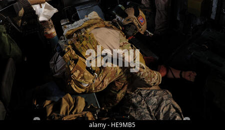 A U.S. Air Force pararescueman, 82nd Expeditionary Rescue Squadron (ERQS), practices tactical combat casualty care - Stock Photo