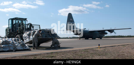Pallets of cargo are offloaded from a Kentucky Air Guard C-130 during an Engine Running Offload at Joint Base McGuire - Stock Photo