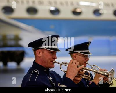 Air Force band members play arrival fanfare music as Lt. Gen. Samuel D. Cox, 18th Air Force commander; Col. John - Stock Photo