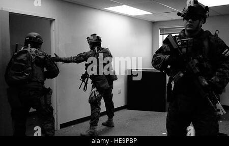 U.S. Marine special operators and U.S. Navy corpsmen participate in close quarters battle training during Emerald - Stock Photo