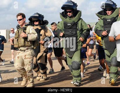 110402-F-XM360-212 CAMP LEMONNIER, Djibouti (April 2, 2011) -- U.S. Navy Lieutenant Junior Grade John Maurus (left), - Stock Photo
