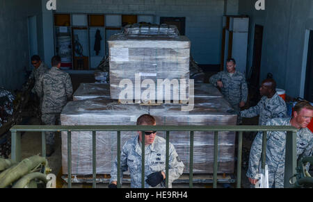 Airmen from the 36th Contingency Response Group prepare packages of humanitarian aid supplies on a pallet for individual - Stock Photo