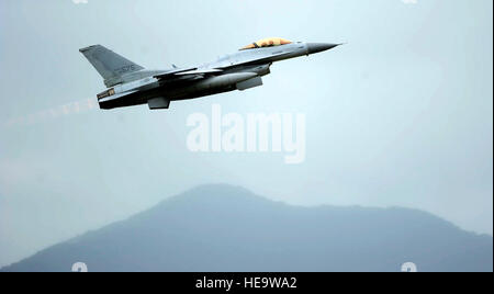 A KF-16 Fighting Falcon from the 19th Fighter Wing takes off at Jungwon Air Base, Republic of Korea, during Buddy - Stock Photo