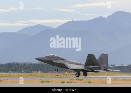 An F-22 Raptor assigned to the 90th Fighter Squadron takes off from Joint Base Elmendorf-Richardson, Alaska, Aug. - Stock Photo
