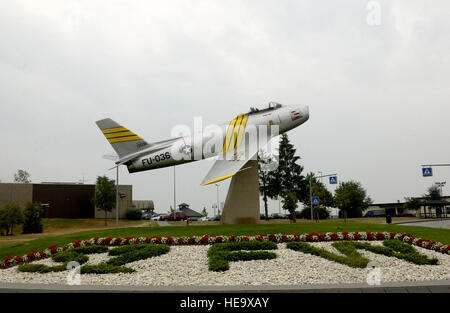 An F-86 Sabre is proudly displayed at the front entrance of  Spangdahlem Air Base, Germany, July 28, 2006.  The - Stock Photo