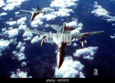 An air-to-air front overhead view of two FB-111 aircraft in formation. - Stock Photo