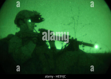 A Marine with Company B, 1st Reconnaissance Battalion, 1st Marine Division, posts security during a night reconnaissance training mission aboard Camp Pendleton, Calif., Sept. 28, 2016. Marines post security while others prepare a concealed observation post undetectable by the enemy.  Lance Cpl. Joseph Prado) Stock Photo
