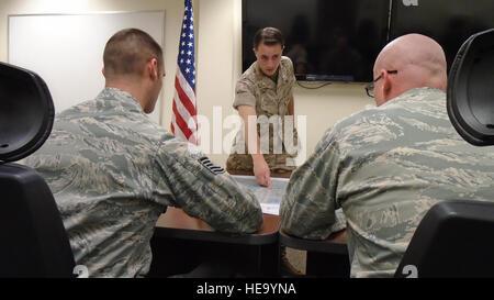 U.S. Marine Corps 1st Lt. Samuel Winsted, F-35B Lightning II intelligence officer, provides a mock intelligence - Stock Photo