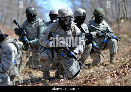 Members of the 106th Rescue Wing Security Forces Squadron conduct their semiannual 'force on force' training at - Stock Photo