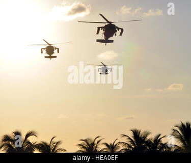 A formation of three UH-60 Black Hawk helicopters assigned to Joint Task Force-Bravo's 1-228th Aviation Regiment - Stock Photo