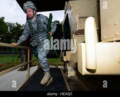 U.S. Army Lt. Col. Kevin Baird, 53rd Transportation Battalion (Movement Control) commander, egresses from a simulated - Stock Photo