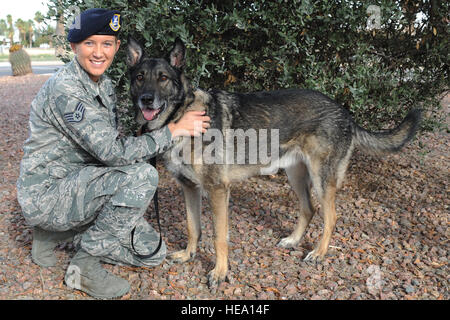 U.S. Air Force Staff Sgt. Alexandra Springman, 355th Security Forces Squadron military working dog handler, and - Stock Photo