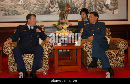Gen. Paul V. Hester discusses military-to-military engagement with Chinese Gen. Ge Zhenfeng July 24 at the August - Stock Photo