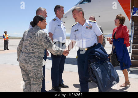 Adm. Paul Zukunft, Commandant of the U.S. Coast Guard, is greeted by Chief Master Sgt.  Idalia Peele, 21st Space - Stock Photo