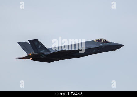 A U.S. Air Force F-35 Lightning II performs an aerial maneuver during the 2016 Heritage Flight Training and Certification - Stock Photo