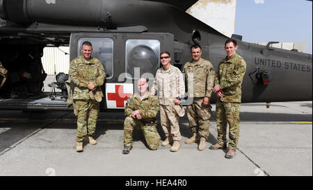 From left, retired Army Cpl. Steve Martin, Army Sgt. Tom Block, Medal of Honor recipient retired Marine Cpl. Kyle Carpenter, Medal of Honor recipient retired Army Master Sgt. Leroy Petry and retired Army Sgt. Ralph Cacciapaglia, pose in front of an HH-60 medical evacuation helicopter during a visit to the Dustoff ramp April 16, 2015 at Bagram Air Field, Afghanistan. The visit was conducted as part of Operation Proper Exit, a program developed to provide closure for service members severely injured in the line of duty.  Staff Sgt. Whitney Amstutz/released)