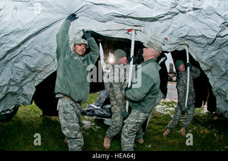 Soldiers with the 1257th Transportation Company, West Virginia Army National Guard, set up [tents] at Yeager Airbase - Stock Photo
