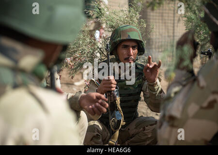 An Iraqi army soldier discusses attack plans for a close-quarters battle training scenario at Camp Taji, Iraq, March - Stock Photo