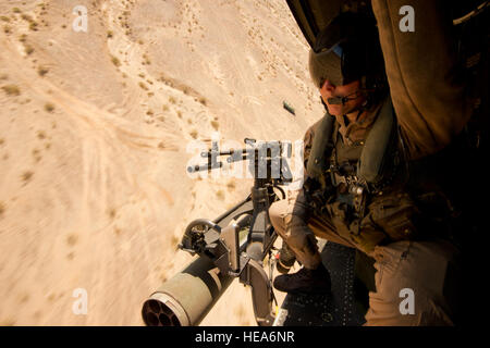 U.S. Marine Corps Sgt. Travis Bell, a UH-1Y Huey 'Venom' helicopter door gunner with Marine Light Attack Helicopter - Stock Photo
