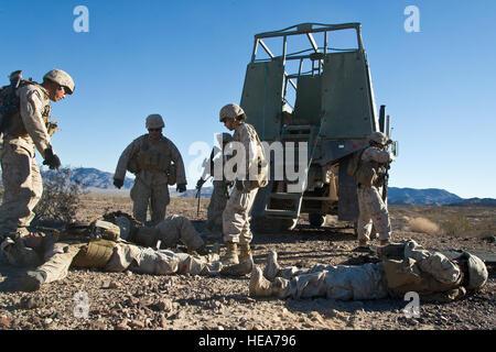 U.S. Marines assigned to 1st Marine Logistics Group, Marine Corps Base Camp Pendleton, evaluate casualties while - Stock Photo