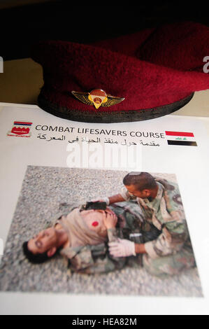 The beret of an Iraqi soldier from the 4th Iraqi Army Engineer Regiment, rests on an instruction binder while U.S. - Stock Photo