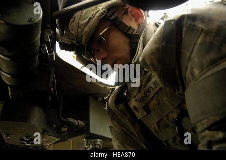 Spc. Andrew Rindfleisch monitors the radios during an Iraqi police led search of villages by the Emergency Services - Stock Photo