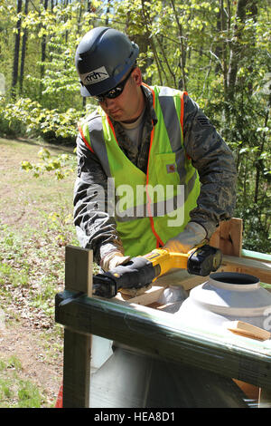 Senior Airman Bradley Ziegler uncrates a new hot water tank to be installed at Camp Hind Boy Scout Camp, Raymond, - Stock Photo