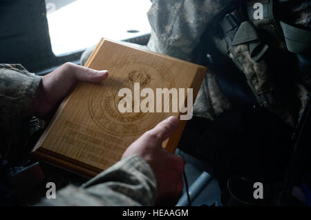 U.S. Army Sgt. 1st Class Kenneth Williams, crew chief assigned to the 1st Battalion, 228th Aviation Regiment, holds - Stock Photo