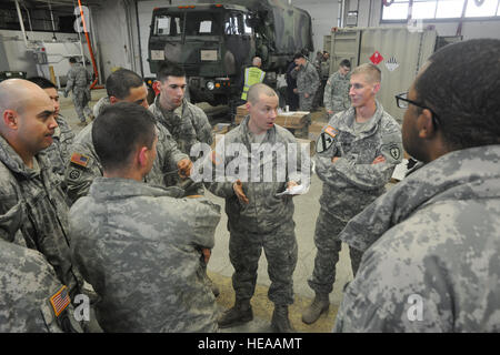 Army Sgt. Joseph Beasley, a native of Anaconda, Mont., a jumpmaster, addresses fellow soldiers assigned to the 4th - Stock Photo