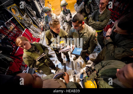 U.S. Air Force aeromedical aircrew members from the 18th Aeromedical Evacuation Squadron, Kadena Air Base, Japan, - Stock Photo