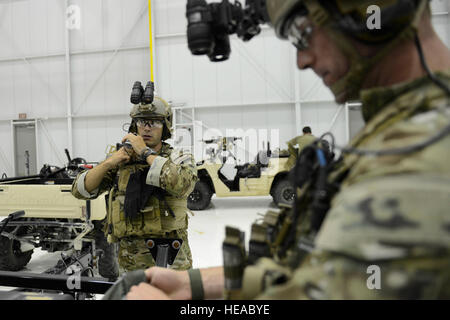 U.S. Air Force Maj. Stephen Kaminski, left, assigned to the 169th Fighter Wing, gets his equipment ready at McEntire - Stock Photo
