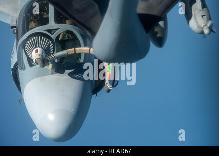 A U.S. Air Force KC-135 Stratotanker assigned to the 379th Air Expeditionary Wing refuels a U.S. Marine Corps EA-6B Prowler over the U.S. Central Command area of operations Dec. 30, 2014. The EA-6B is a mid-wing electronic warfare aircraft that can jam enemy air defense systems, radar and gather radio intelligence.  Senior Airman James Richardson/AFCENT/)
