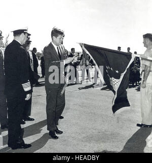 President John F. Kennedy places a streamer on the colors of the 363rd Tactical Reconnaissance Wing to present the - Stock Photo