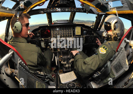Capt. Nate Mueller, 20th Bomb Squadron aircraft commander, and 1st Lt. Dan Ecktebe, 20 BS co-pilot, talk while conducting - Stock Photo