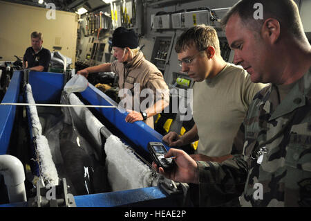 HICKAM AFB - U. S. Air Force Master Sgt. Chad Knudson, a native of Wolf Point, Montana uses his cell photo to take - Stock Photo
