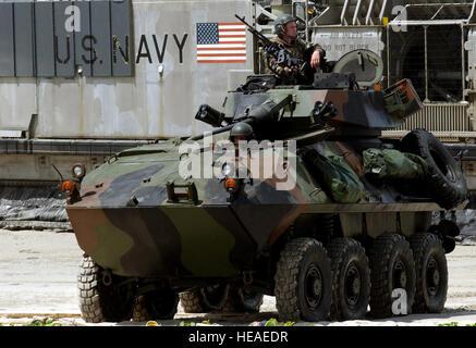 US Marine Corps (USMC) Marines drive their Light Armored Vehicle (LAV-25) along the beach at Samesan Royal Thai - Stock Photo