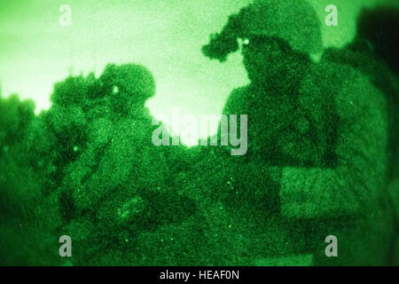 Marines wait to move into an enemy compound during a night raid training evolution aboard Marine Corps Base Camp - Stock Photo