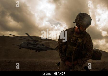 U.S. Marine Cpl. Justin Smith, 13th Marine Expeditionary Unit (MEU) Battalion Landing Team 1/4, turns away while - Stock Photo