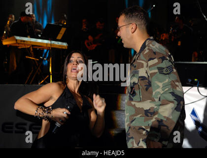Ponce, Puerto Rico native Staff Sgt. Julio Rodriguez dances with Melina Leon during a performance of Operation Season's - Stock Photo