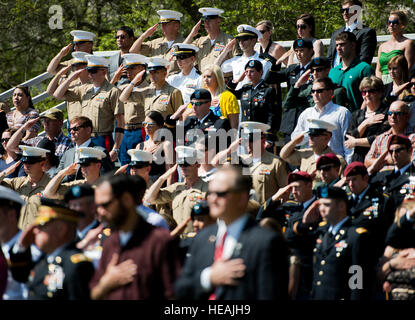 Army and Marine explosive ordnance disposal technicians salute during the 45th Annual EOD Memorial Ceremony May - Stock Photo