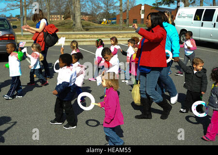 Pershing Child Development Center children and personnel participate in a Month of the Military Child march at Fort - Stock Photo