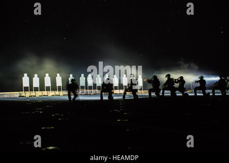U.S. Marines with Maritime Raid Force, 13th Marine Expeditionary Unit, conduct a deck shoot at night during their - Stock Photo