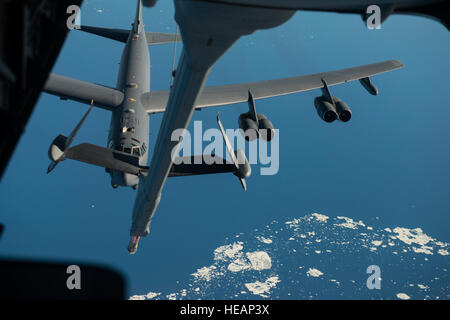 A B-52 Stratofortress from Minot Air Force Base, N.D., approaches a KC-10 Extender, from the 305th Air Mobility - Stock Photo