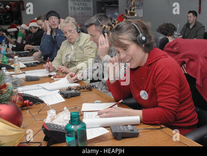 PETERSON AIR FORCE BASE, Colo. - Jennifer Eckels, first time NORAD Tracks Santa volunteer, takes calls at the NORAD - Stock Photo