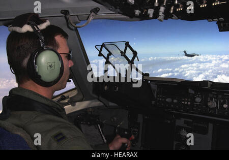 An air-to-air view from the flightdeck of a C-17A Globemaster III as both aircraft return to Germany after the successful - Stock Photo