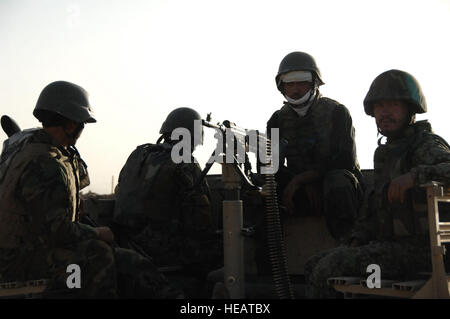 An Operational Detachment Alpha Team prepares to roll out for a Medical engagement in Khakrez, Afghanistan. They - Stock Photo