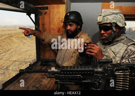 U.S. Navy Petty Officer 3rd Class Dain Dillon, a Paktika Provincial Reconstruction Team convoy driver from Miami, - Stock Photo