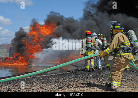 U.S. Air Force firefighters from the 433rd Civil Engineering Squadron, Lackland AFB, Texas, and 512th Civil Engineering - Stock Photo
